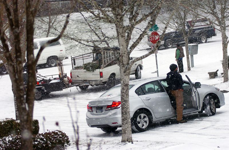 by: TRIBUNE PHOTO: DAN BROOD - Drivers found themselves without traction Thursday afternoon in Beaverton as snow hit the region.