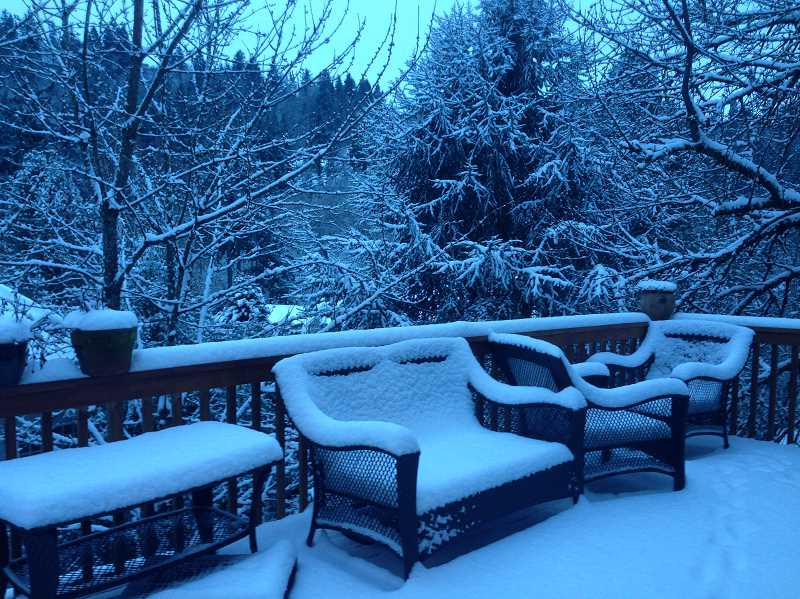 by: SUBMITTED PHOTO: HEATHER KARABEIKA - The snow on West Linn resident Heather Karabeika's patio was piling up Friday morning.