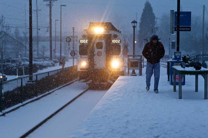 by: TIMES PHOTO: JAIME VALDEZ - A TriMet WES train arrives from Beaverton at the Tigard Transit Center on Southwest Commercial Street.