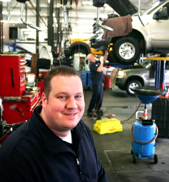 by: OUTLOOK PHOTO: JIM CLARK - Ryan Johnson, service adviser at Gresham Ford, was once an automotive technician. For the past six years, he has gone out of his way to make sure the dealerships customers are satisfied with their service and repair experience.