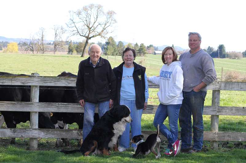 by: HILLSBORO TRIBUNE PHOTO: STEPHANIE HAUGEN - (Left to right) Hans, Sally, Casey and Dave stand in front of grazing cows on the place they all call home -- the Schoch Dairy.