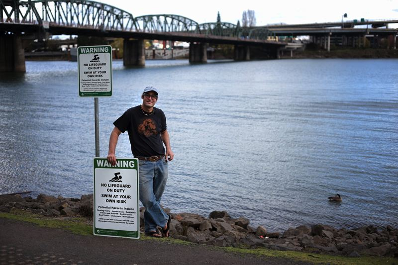 by: PAMPLIN MEDIA GROUP PHOTO: JONATHAN HOUSE - Will Levenson is working with the Porland Parks and Recreation to install new signs at the Tom McCall waterfront beach.