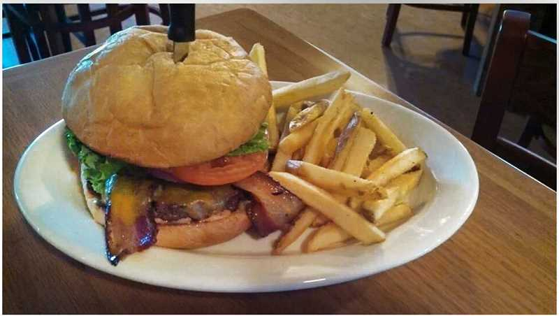 by: CONTRIBUTED PHOTO - Word has been spreading about the exquisite gourmet burgers at Bailey's Pub & Grub.