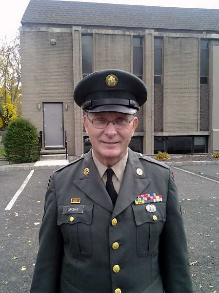 by: CONTRIBUTED PHOTO - Michael Dingman in uniform last year on Veterans Day after speaking at an event.