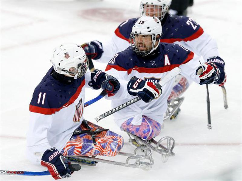 by: COURTESY PHOTO - Shown here playing sled hockey for the gold medal-winning U.S. Paralympics Team in Sochi, Russia, in February, Marine Sgt. Josh Sweeney and his family will soon move to Hillsboro. Their new home is being provided by Homes For Our Troops, a national nonprofit.