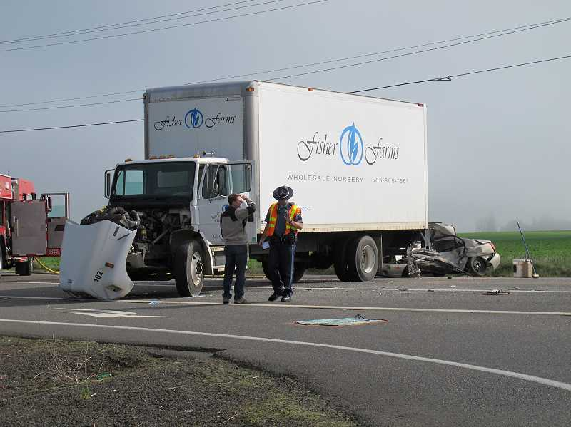 by: NEWS-TIMES PHOTO: JILL REHKOPF SMITH - Driver Cory Jensen slammed on the brakes when a four-door Hyundai pulled in front of his Fisher Farms truck, causing it to skid until it finally came to a stop broadside across Highway 47, with the crumpled car behind it.