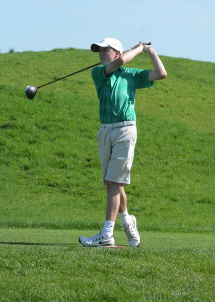 by: TIMES PHOTO: MATT SINGLEDECKER - Jesuit freshman Danny Terrell tees off on the 17th hole at Langdon Farms on Monday.