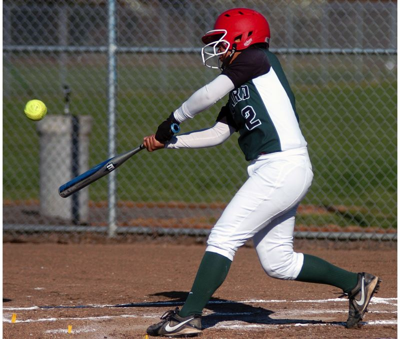 by: DAN BROOD - KOROK KRUSH -- Tigard High School sophomore Kalyna Korok, shown here in an early-season game, could be a standout for the Tigers in the infield and at the plate.