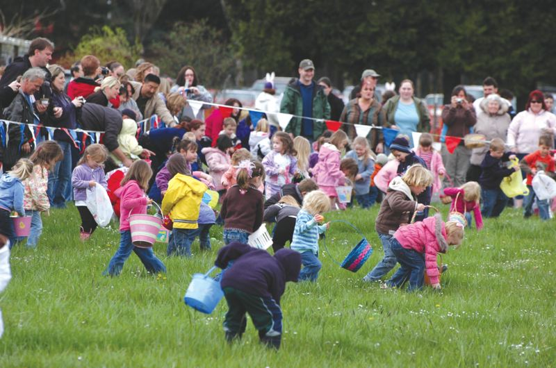 by: SPOTLIGHT FILE PHOTO - Children fan out in search of candy- and toy-filled plastic Easter eggs at the annual mEGGa Egg Hunt at the Columbia County Fairgrounds. This year's hunt is scheduled for Saturday, April 19.