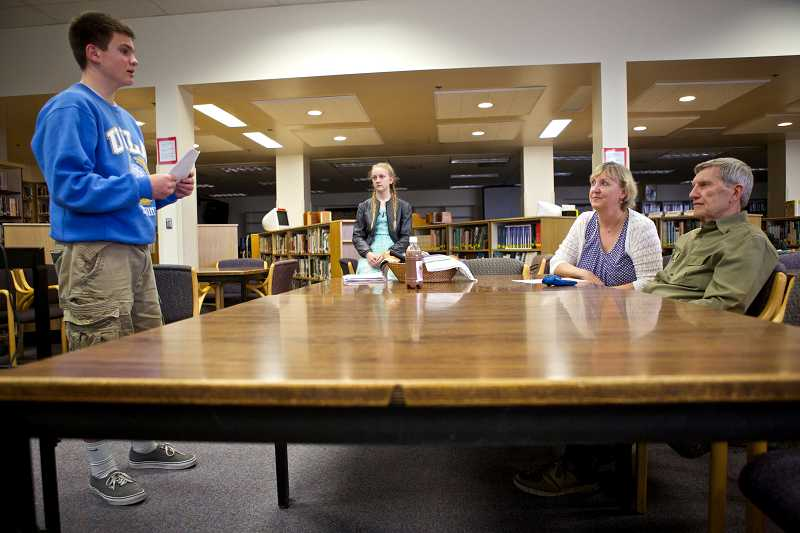 by: TIMES PHOTO: JAIME VALDEZ - Jacob Faulk, above, practices his business proposal, 'Bring the Heat Designs,' with business mentor Dean Buse and Evelyn Orr, Young Entrepreneurs Academy program manager, on Tuesday afternoon at Beaverton High School. Faulk is one of 12 students pitching business ideas to potential investors at PCC Rock Creek on April 16.