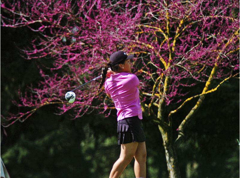 by: DAN BROOD - THE COLORS -- Tualatin junior Janelle Decker watches her drive on hole No. 13 at Monday's tournament.