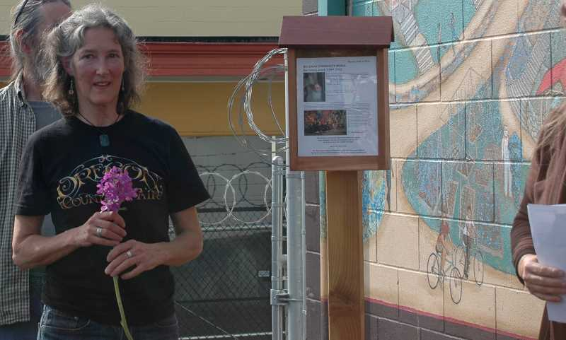 by: ISABEL GAUTSCHI - Kolieha, wife of the late muralist and public art advocate Joe Cotter,  shared memories of the painting of the Buckman Community Mural.
