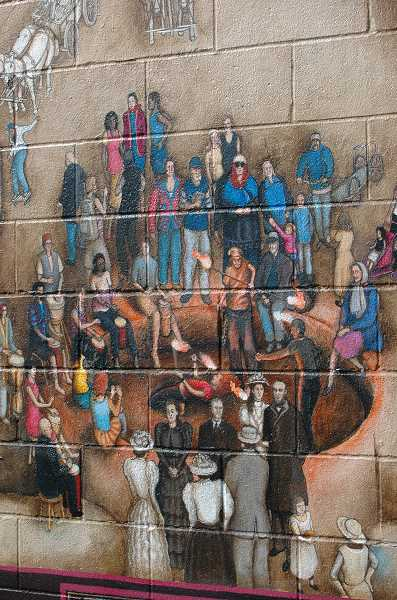 by: ISABEL GAUTSCHI - Cotter creatively combined different eras from the neighborhood's history  in the Buckman Community Mural.