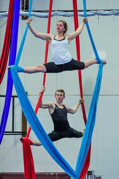 by: TIMES PHOTO: JOHN LARIVIERE - Liza Myachina (top) and Taylor Hill (below) perform a synchronized aerial routine with silks.