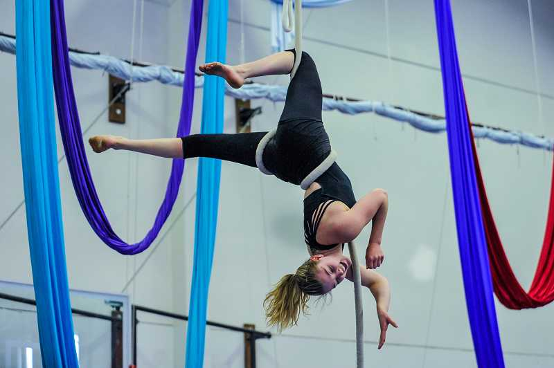 by: TIMES PHOTO: JOHN LARIVIERE - Rosie Rogmans performs an aerial routine on ropes.