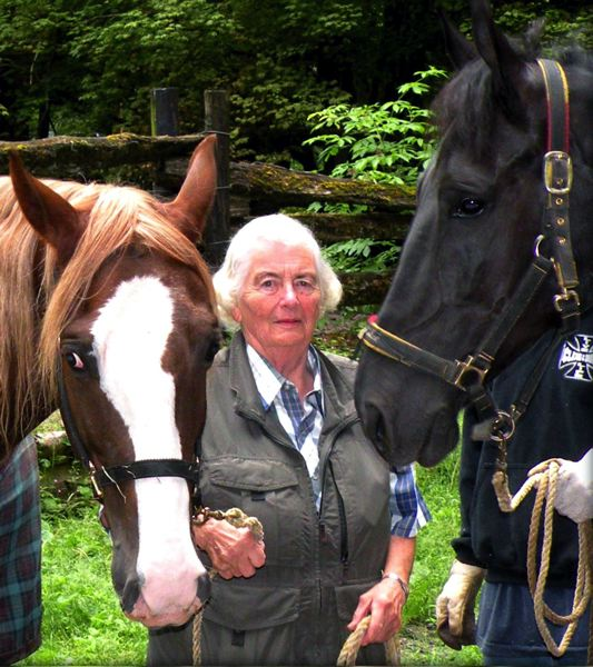 by: CONTRIBUTED PHOTO - Joie Smith with her favorite horses, Floyd and Sam. A couple months before her passing, Smith rode in a truck into the area to see them. Sam stuck his head through the window to say goodbye.