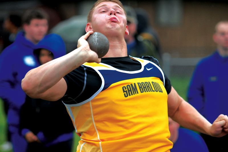 by: THE OUTLOOK: DAVID BALL - Barlows Garrett Stauffer lets loose with a throw in the shot put. He finished second in the event and would also take second in the discus later in the day.