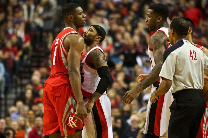 by: TRIBUNE PHOTO: JAIME VALDEZ - Terrence Jones (left) of the Houston Rockets and Mo Williams of the Trail Blazers wind up with technical fouls after a run-in during Game 4 of the teams' NBA playoff series Sunday night at Moda Center.
