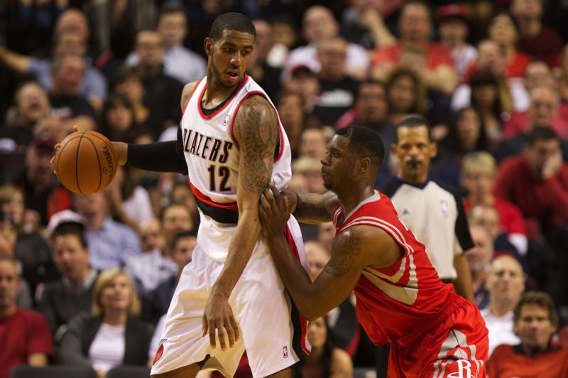 by: TRIBUNE PHOTO: JAIME VALDEZ - Terrence Jones (right) tries to get some defensive leverage against his power forward counterpart, LaMarcus Aldridge.