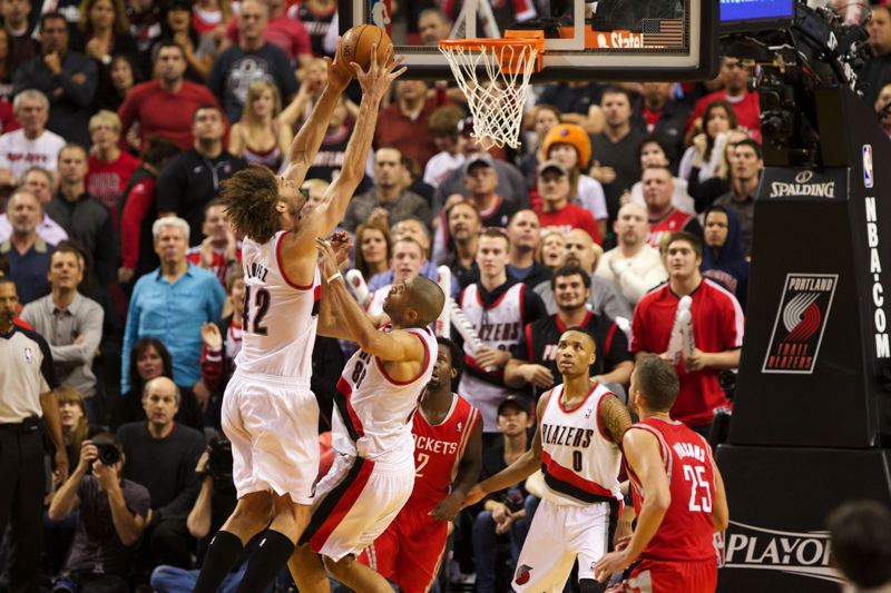 Blazers center Robin Lopez grabs a rebound in overtime.