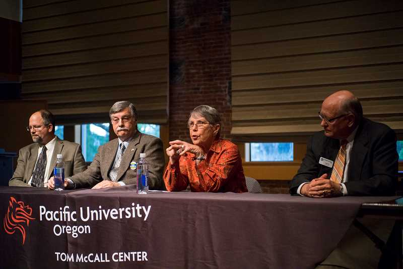 by: NEWS-TIMES PHOTO: CHASE ALLGOOD - Washington County Commission candidates Andy Duyck, Allen Amabisca, Elizabeth Furse and Bob Terry take questions from the audience at a forum Monday evening at Pacific University.