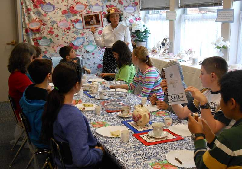 by: REVIEW PHOTO: JILLIAN DALEY - Lake Grove students enjoy an English tea, for which volunteer Karen Chi served as tea steward.