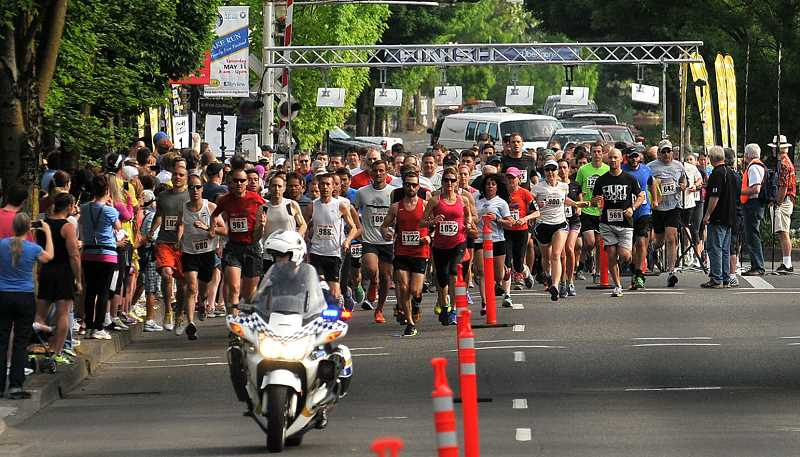 by: REVIEW FILE PHOTO: VERN UYETAKE - About 1,400 people participated in the Lake Run last year.