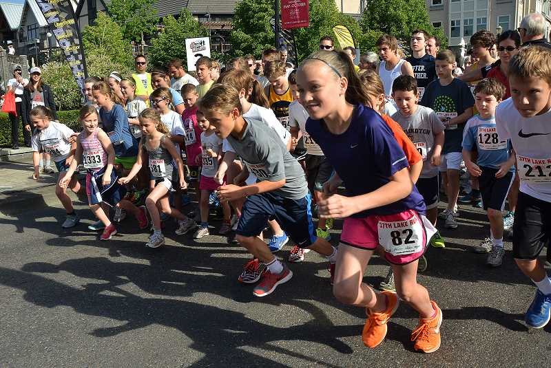 by: REVIEW FILE PHOTO: VERN UYETAKE - There not only are events for adults but also the Kids Dash, a race for children.
