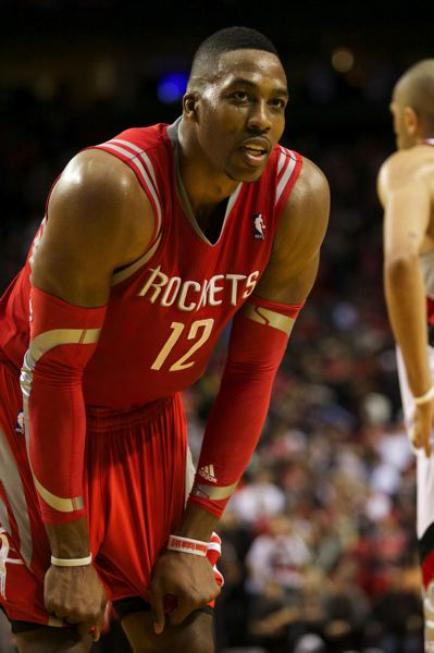by: TRIBUNE PHOTO: JAIME VALDEZ - Dwight Howard and the Houston Rockets earned a return trip to Portland for Game 6 after defeating the Trail Blazrs 108-98 on Wednesday.
