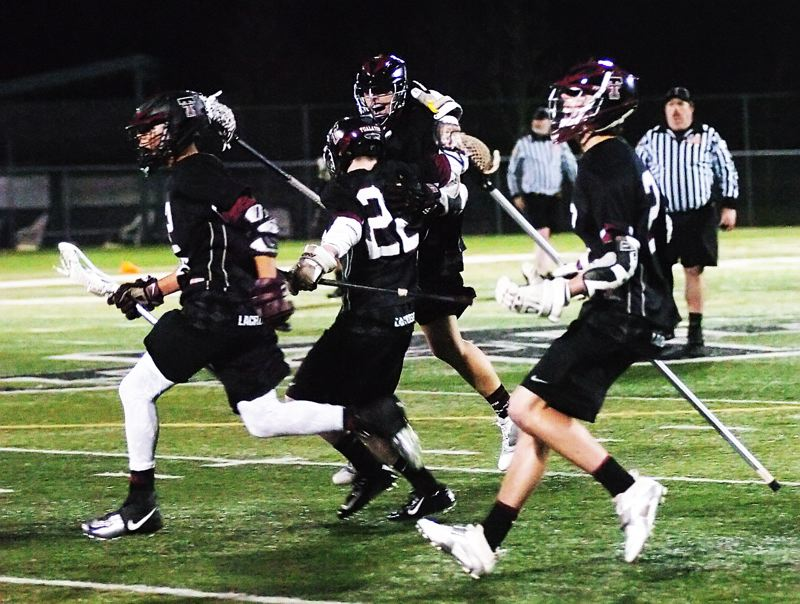 by: DAN BROOD - WE WIN -- Members of the Tualatin High School boys lacrosse team start celebrating following their last-second victory over Tigard.