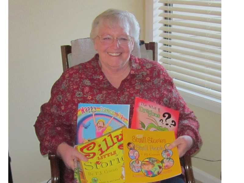 by: FILE PHOTO/REGAL COURIER - KEEPS ON PUBLISHING - PJ Cowan was photographed with a handful of her books in 2012.