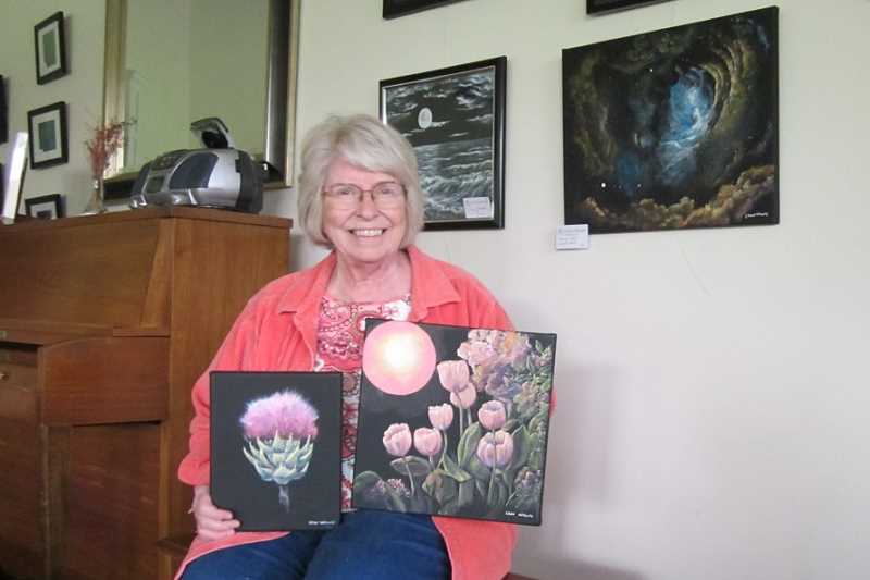 by: BARBARA SHERMAN - GALACTIC ART - Lynn Wolfe, shown with three of her paintings, came up with the idea of King City Artists Guild members all following the same theme each month for their works that hang in the Clubhouse.