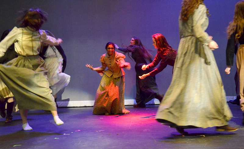 by: REVIEW PHOTO: VERN UYETAKE - Sima Anekonda (Tituba) and other actors practice the dance that gets the teens in trouble in 'The Crucible.'