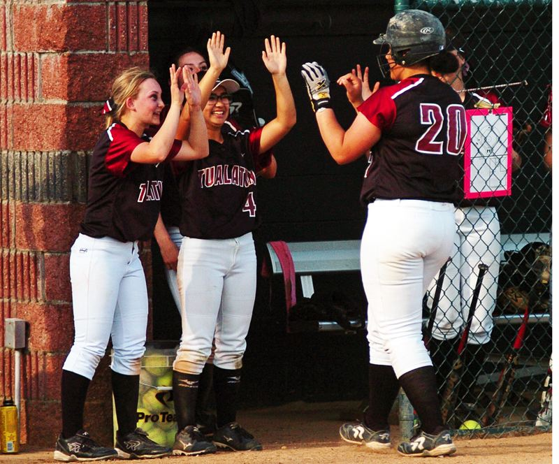 by: DAN BROOD - NICE HIT -- Tualatin High School junior Nikki Miller (20) is congratulated by teammates Tanna Baggenstos (left) and Caitlyn Sung following her double against Glencoe.