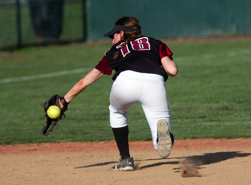 by: DAN BROOD - BACKHAND -- Tualatin junior shortstop Joslyn Gastiaburu makes a stop during the Wolves' win over Glencoe.