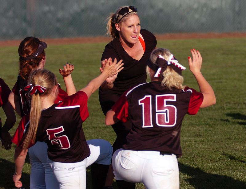 by: DAN BROOD - ALL AROUND -- Tualatin coach Jenna Wilson gives high fives to the Timberwolf players following the 11-0 victory over Glencoe.