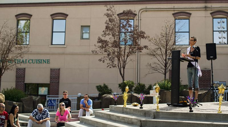by: HILLSBORO TRIBUNE PHOTO: CHASE ALLGOOD - Cindi Luther, an Aloha resident and a member of Hillsboros Orenco Presbyterian Church, addresses a small group of people who assembled last Thursday, May 1, at the Hillsboro Civic Center fountain to observe the 2014 National Day of Prayer. The local gathering was sponsored by the Washington County Re-entry Council, a coalition of individuals and organizations that help former inmates successfully reintegrate into society.
