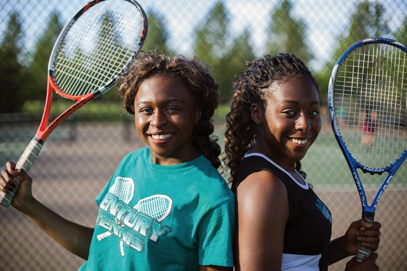 by: HILLSBORO TRIBUNE PHOTO: CHASE ALLGOOD - Century junior Eka Essien (left) and her sister, sophomore Neyen Essien, will be favorites to advance deep in next week's Pacific Conference girls tennis tournament in McMinnville.