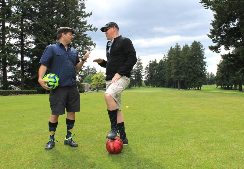 by: OUTLOOK PHOTO: CARI HACHMANN - Friends Brad Cownover and Tom Vice of Southeast Portland go over their game plan for their first-ever attempt at footgolf.