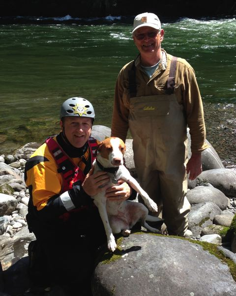 by: CONTRIBUTED: CLACKAMAS COUNTY SHERIFF - Clackamas County Sheriff's Marine Unit Deputy Morgan Guthner, left, holds Mazy, who was rescued from the Sandy River after jumping out of the boat of his owner, Mark Barham, right.