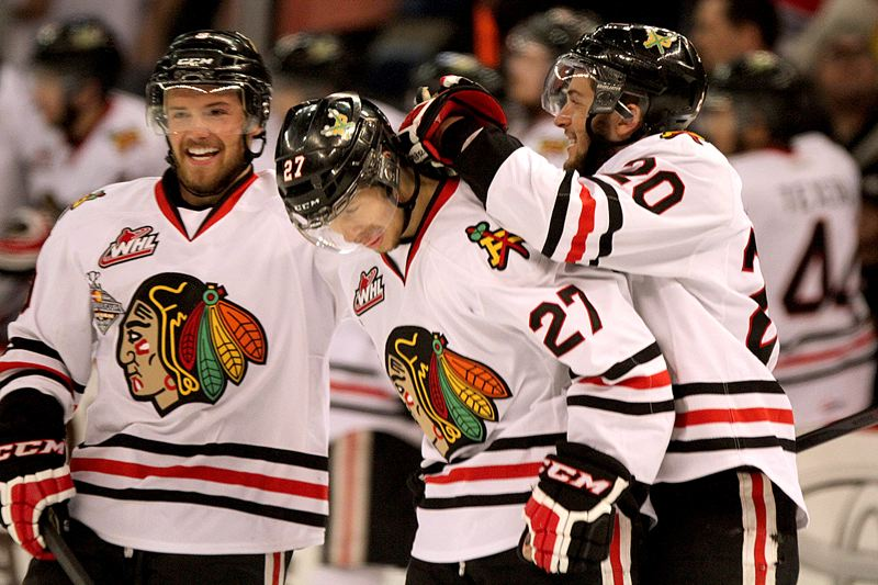 by: TRIBUNE PHOTO: JONATHAN HOUSE - Portland Winterhawks Chase De Leo, Oliver Bjorkstrand and Taylor Leier celebrate Bjorkstrand's goal in the first period of Game 7 Monday night.