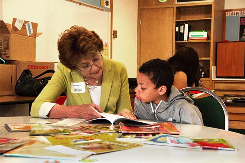 by: CONTRIBUTED PHOTO - Multnomah County Commissioner Diane McKeel, whose district spans east Multnomah County, reads with Montrell Wilson at Lynch View Elementary during SMARTs Reading Matters event Friday, May 2.