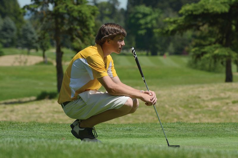 by: JOHN WILLIAM HOWARD - Jacob Roxey, the Lions' leader at the Northwest Oregon Conference championships, surveys a putt at the fifth hole on the second day of competition at The Reserve in Aloha.