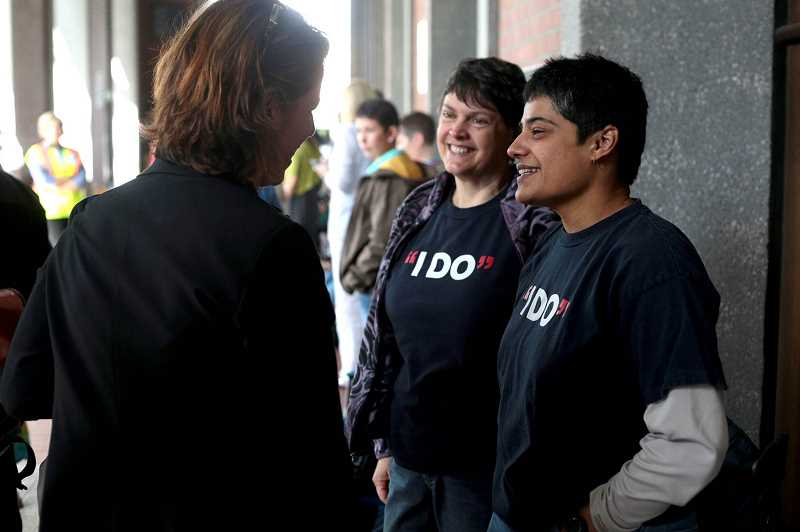 by: PAMPLIIN MEDIA GROUP PHOTO: JONATHAN HOUSE - Hillsboro residents Laurel Gregory (center) and Shilpa Banerjee (right) talk with Commisisoner Deb Kafoury outside the Multnomah County Courthouse just before Judge Michael McShane issues his historic ruling Monday afternoon.