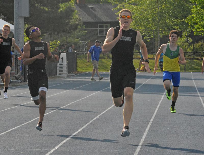 by: TIMES PHOTO: MATT SINGLEDECKER - Jesuit's Max Dordevic and Carlos Coleman finished first and second in the 400-meter dash at the Metro League District Championship on Friday.
