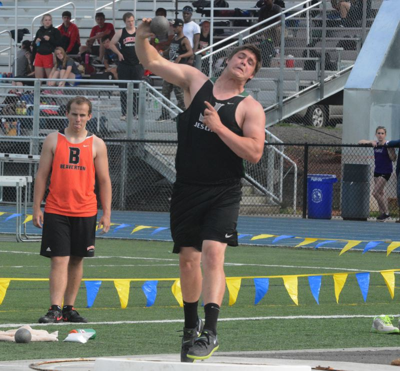 by: TIMES PHOTO: MATT SINGLEDECKER - Jesuit senior thrower Henry Mondeaux took first in the shot put and discus at the Metro League District Championship on Friday at Aloha High School.