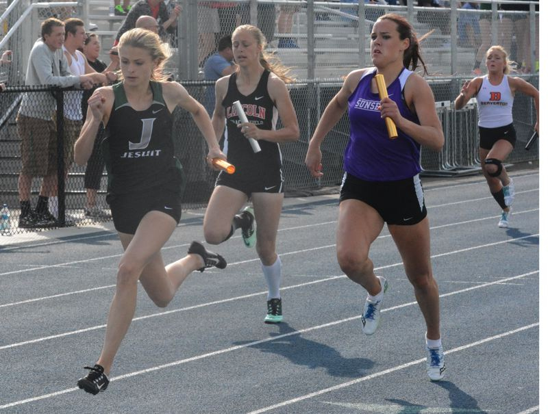 by: TIMES PHOTO: MATT SINGLEDECKER - Jesuit freshman Claire Corbitt got past Sunset's Taylor Coon to help the Crusader girls win the 4x100 relay at the Metro District Championship on Friday.