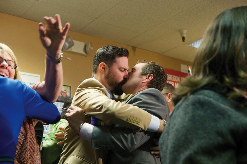 by: TRIBUNE PHOTO: JAIME VALDEZ - Ben West and his partner Paul Rummell kiss after celebrating Judge McShanes ruling Monday afternoon. West and Rummell were two plaintiffs in one of the federal lawsuits that overturned the states ban on same-sex marriage.