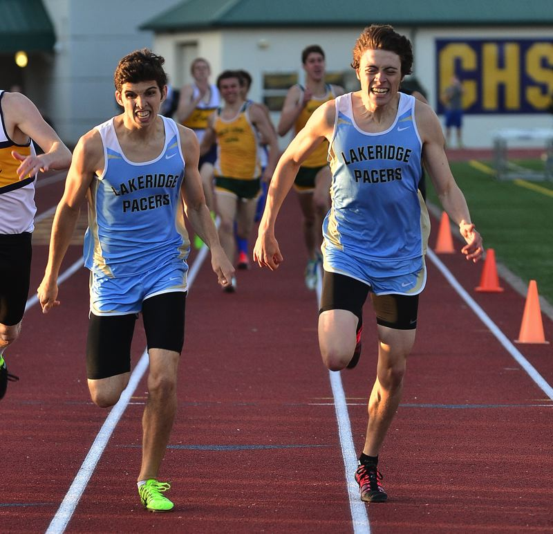 by: VERN UYETAKE - Lakeridge's Tim Jordan and Corrado Pitari stretch for the line in the final of the 800 at the district track meet. They both qualified for state with Pitari winning by five hundredths of a second.