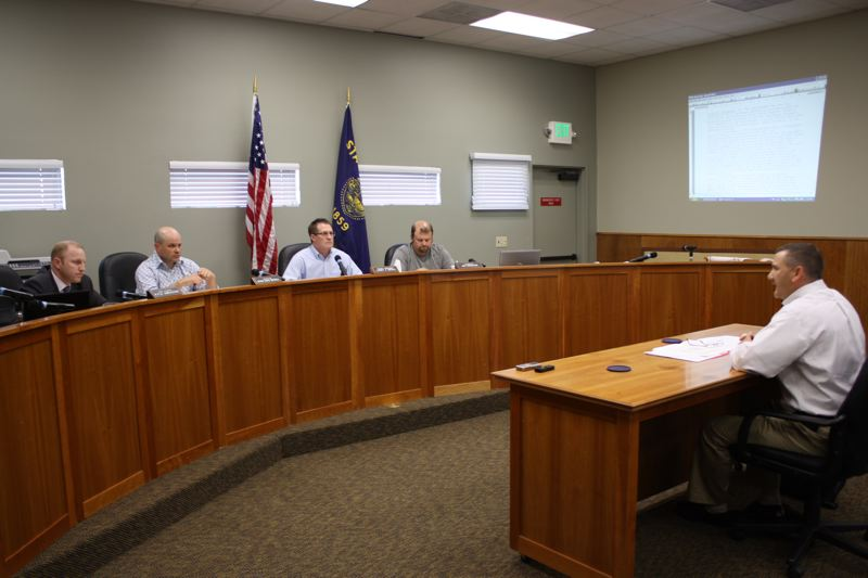 by: SPOTLIGHT PHOTO: ROBIN JOHNSON - Doug Greisen, recently terminated from his position as Scappoose Police Chief, sits before a committee of Scappoose city councilors. The committee is tasked with determining whether the termination fell withing existing law and policy.